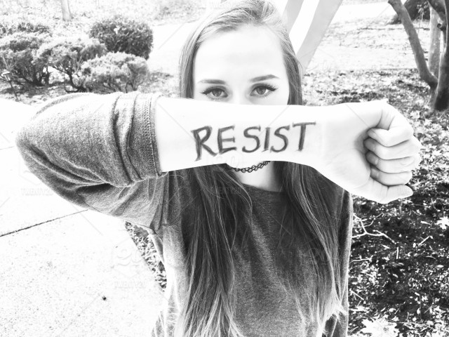 stock-photo-women-black-and-white-young-woman-woman-peaceful-protest-political-resistance-activism-191113bc-9124-43c4-8e60-dc62374c01d3